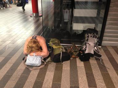 The evening after the night before, at Prague station.