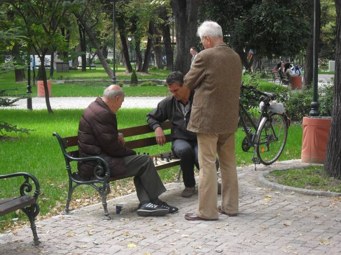 Old men playing chess in the Tsar Simeon gardens.