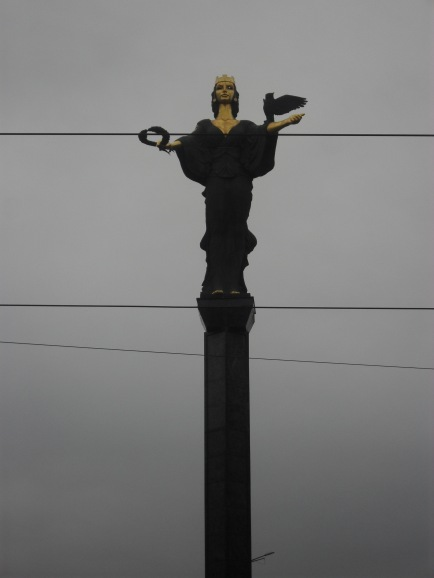 Saint Sofia statue, imperious over the road.