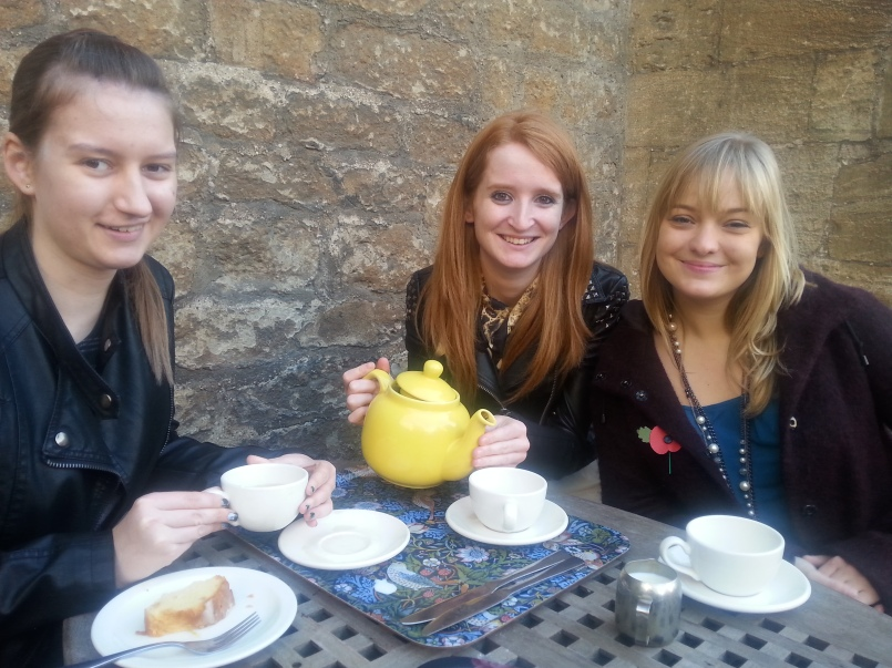 Leah, Emily and Olivia with their beloved yellow teapot, at The Vault.